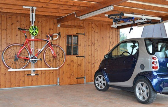 flat bike lift bike rack that folds into the ceiling geekextreme. Black Bedroom Furniture Sets. Home Design Ideas