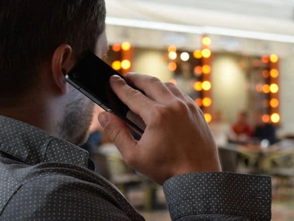 man talking on the phone smartphone