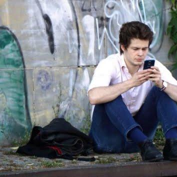 nerd texting phone