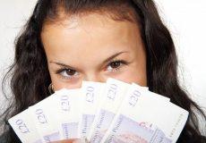 woman holding cash