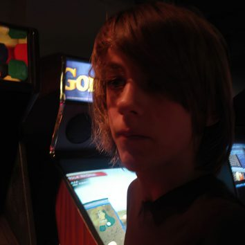 young person in arcade