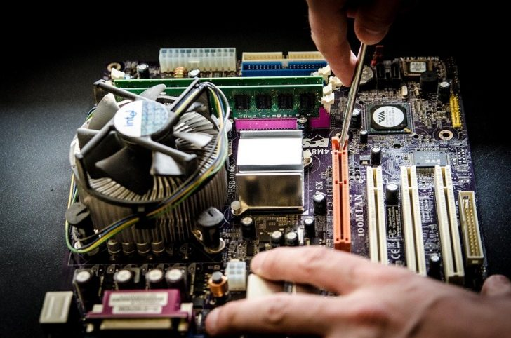 person working on motherboard