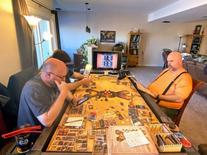 nerds playing gloomhaven