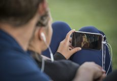 person watching video on phone