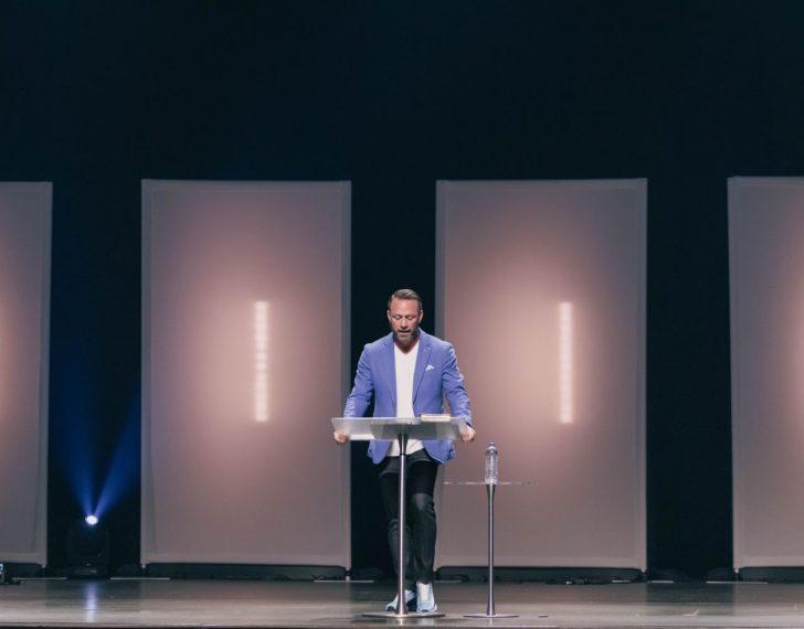 man giving a speech on a podium