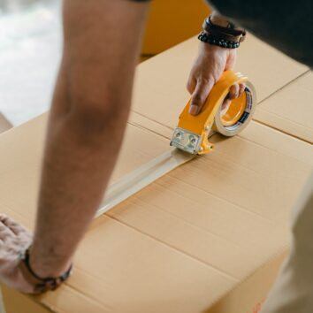 person taping box
